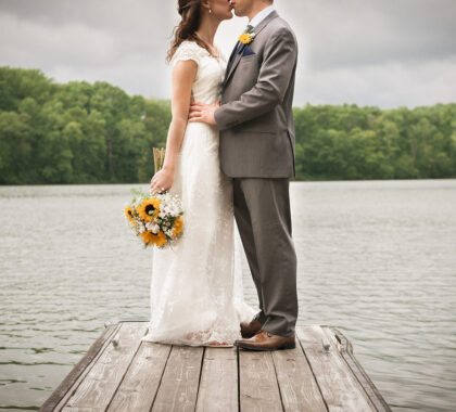 Bride and Groom kissing on the dock