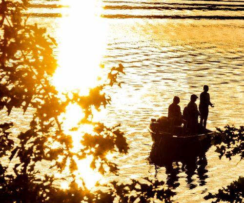 Family fishing at sunset