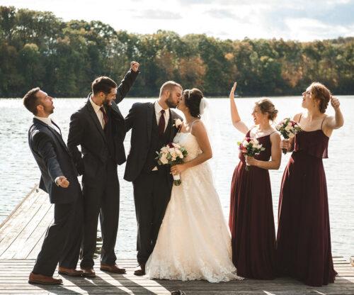 Wedding party celebrating on the dock
