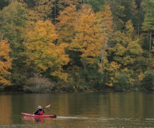 Kayaker on lake in the Fall