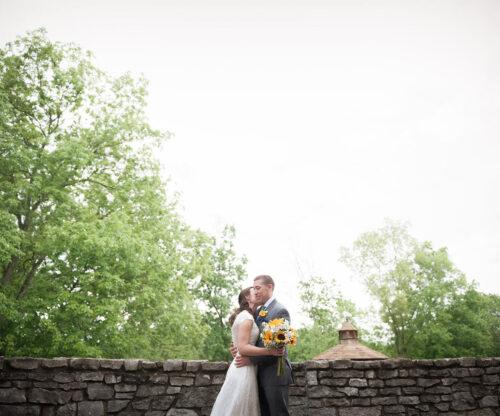 Bride and Groom on stone bridge
